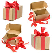 Open present box with red ribbon bow isolated on white — Stock Photo