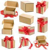 Collection present boxes with red ribbon bows isolated on white — Stock Photo
