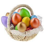 Painted colorful easter eggs in wooden basket, isolated on white — Stock Photo