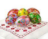 Colorful easter egg, hand painted on easter towel, card on white — Stock Photo