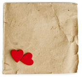 Red hearts on vintage paper background with copyspace — Stock Photo