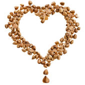 Buckwheat groats in shape heart Isolated on white background — Stock Photo