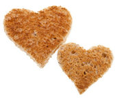 Stycke bröd skuren i form av hjärta isolerad på vit bakgrund — Stockfoto