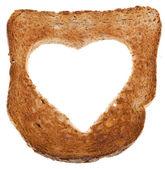 Torrada de pão corta buraco em forma de coração isolada no fundo branco — Foto Stock