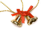 Christmas bells with red bows — Stock Photo