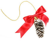Christmas cone with red bow on white background — Stock Photo