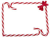 Frame of christmas lollipop cane isolated on white — Stock Photo