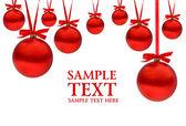 Julkort med röda bollar och band med plats för din text — Stockfoto