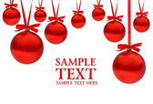 Kerstkaart met rode ballen en linten met ruimte voor uw tekst — Stockfoto