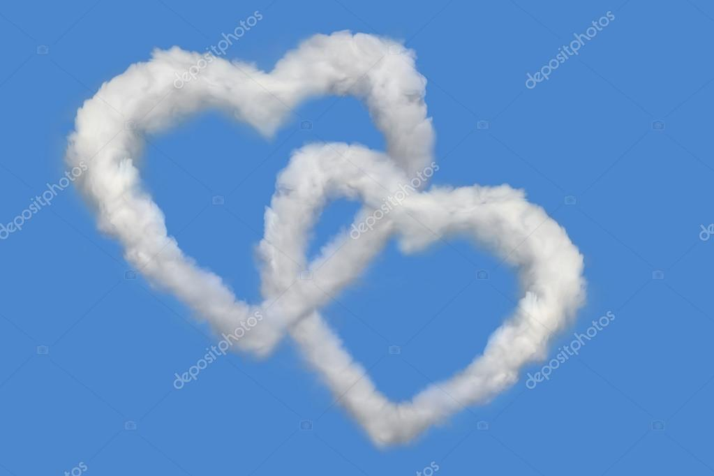 Two clouds in the form of heart in the blue sky — Stock Photo #13837591