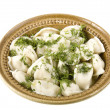 Dumplings on white clay plate - Stock Photo