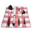 Antique silverware, fork, knife and spoon on the kitchen dining napkin in a cell — Stock Photo