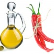 Decanter with olive oil and red hot peppers isolated on white background — Stock Photo #13991759