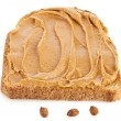 Peanut butter sandwich and peanuts on white background - Stock Photo