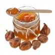 Fig jam in glass with on spoon on white background — Stock Photo #13992860