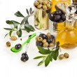 Olives canned and olive oil decanter on white background — Stock Photo