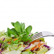 Mixed fresh vegetable salad in bamboo dish with fork — Stock Photo