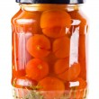 Tomatoes vegetables canned in glass jars — Stock Photo #13998997
