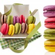 Colorful macaroons in a paper box with holiday ribbon isolation on a white background — Stock Photo #13999480