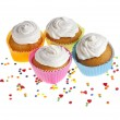 Cupcakes with colorful sprinkles on white background — Stock Photo #13999698