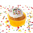 Cupcakes with colorful sprinkles on white background — Stock Photo #13999702