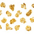 Pieces of caramel popcorn isolated on white - Stock Photo