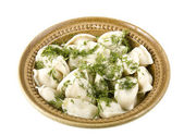 Dumplings on white clay plate — Stock Photo