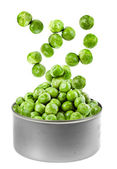 Canned green peas jumping out of a tin — Stock Photo