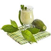 Avocado smoothie on kitchen napkin isolated on white background — Stock Photo