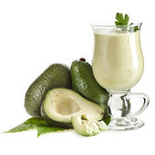 Avocado smoothie on kitchen napkin isolated on white background — Stock Photo