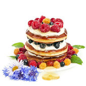 Pancakes stack with sour cream and fresh berries on white background — Stock Photo