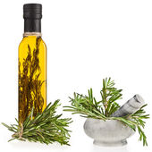 Rosemary oil bottleand mortar with fresh rosemary isolated on white background — Stock Photo