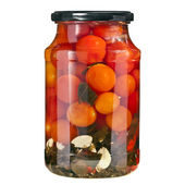 Tomatoes vegetables canned in glass jars — Stock Photo