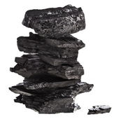 Stack tower of black coal isolated on white background — Stock Photo