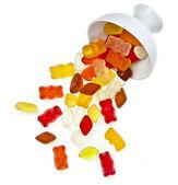 Färgglada gummy godis i en skål som isolerad på vit — Stockfoto
