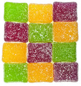 Colorful fruit jelly candy on white backdrop — Stock Photo
