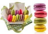 Colorful macaroons in a paper box with holiday ribbon isolation on a white background — Stock Photo