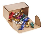 Present cardboard box with colorful candies isolated on white — Stock Photo