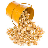 Popcorn with caramel in a bucket isolated on white — Stock Photo