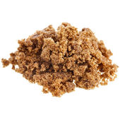 Pile of brown dark sugar on white background — Stock Photo