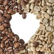 Frame of unroasted and brown coffee beans in shape heart on white background - Foto Stock