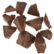 Chocolate pieces isolated on white - Stock Photo