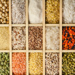Variation of lentils, beans, peas, soybeans, legumes in wooden box — Stock Photo