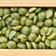 Green peas in wooden frame box - Stock Photo