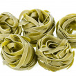 Dry nest pasta on white background - Stock Photo