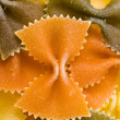 Tricolour dry pasta farfalle background — Stock Photo
