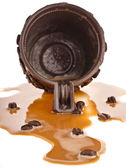 Spilled Coffee of coffee cup on white background — Stock Photo