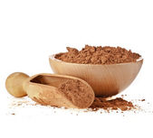Cocoa powder with wooden scoop isolated on white background — Stock Photo