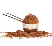 Cocoa powder with scoop isolated on white background — Stock Photo