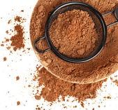 Cocoa powder on white background — Stock Photo